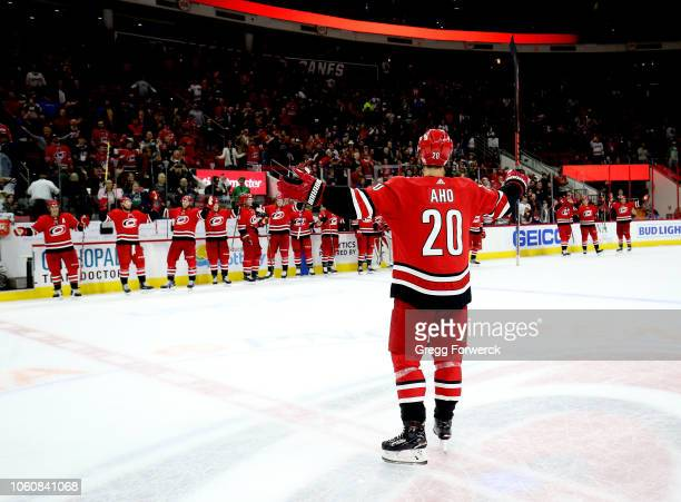 Sebastian Aho of the Carolina Hurricanes leads the post game storm surge celebration following a win over the Chicago Blackhawks during an NHL game...