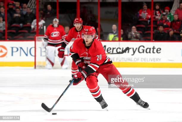 Sebastian Aho of the Carolina Hurricanes moves the puck on the ice during an NHL game against the Boston Bruins on March 13 2018 at PNC Arena in...