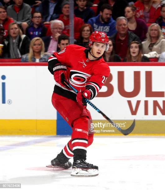 Sebastian Aho of the Carolina Hurricanes passes the puck during an NHL game against the New York Islanders on February 16 2018 at PNC Arena in...