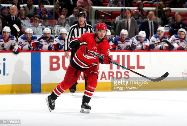 Sebastian Aho of the Carolina Hurricanes passes the puck during an NHL game against the New York Rangers on March 31 2018 at PNC Arena in Raleigh...