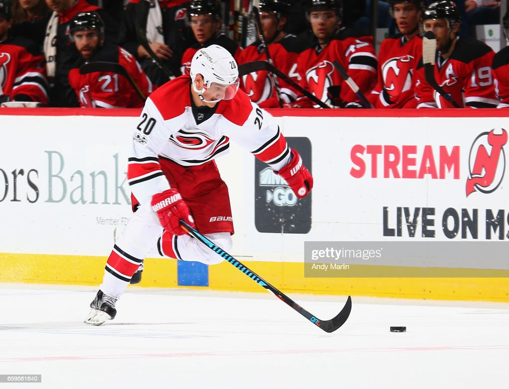 Sebastian Aho #20 of the Carolina Hurricanes plays the puck against the New Jersey Devils during the game at Prudential Center on March 25, 2017 in Newark, New Jersey.