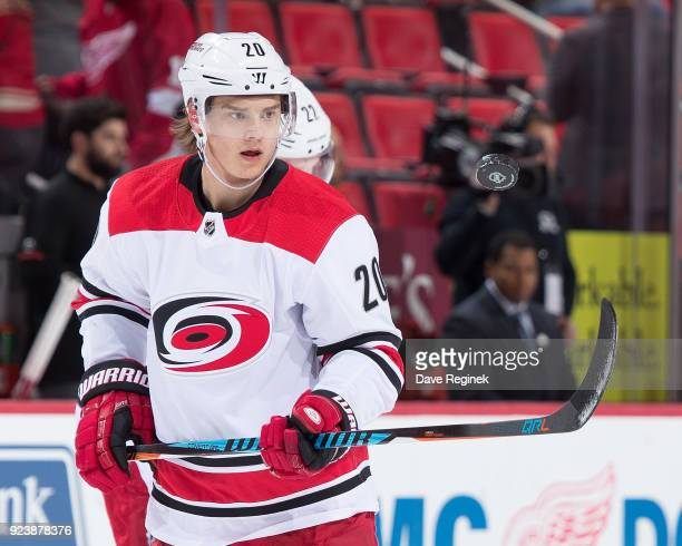Sebastian Aho of the Carolina Hurricanes plays with a puck during warmups prior to an NHL game against the Detroit Red Wings at Little Caesars Arena...