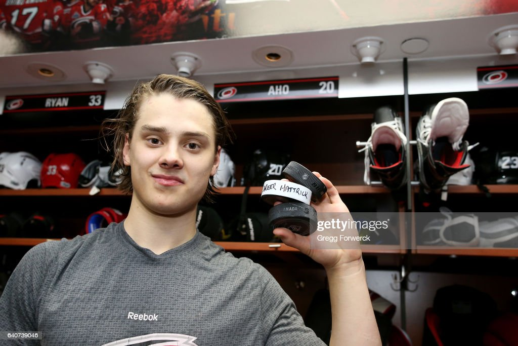 Sebastian Aho #20 of the Carolina Hurricanes poses with 3 pucks as he celebrates his first NHL hat trick during an NHL game against the Philadelphia Flyers on January 31, 2017 at PNC Arena in Raleigh, North Carolina.