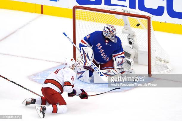 Sebastian Aho of the Carolina Hurricanes scores a goal on Igor Shesterkin of the New York Rangers during the third period in Game Three of the...