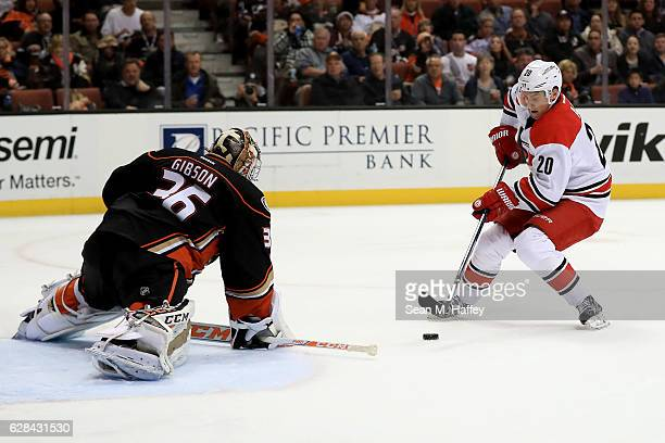 Sebastian Aho of the Carolina Hurricanes scores a goal past John Gibson of the Anaheim Ducks during the second period of a game at Honda Center on...