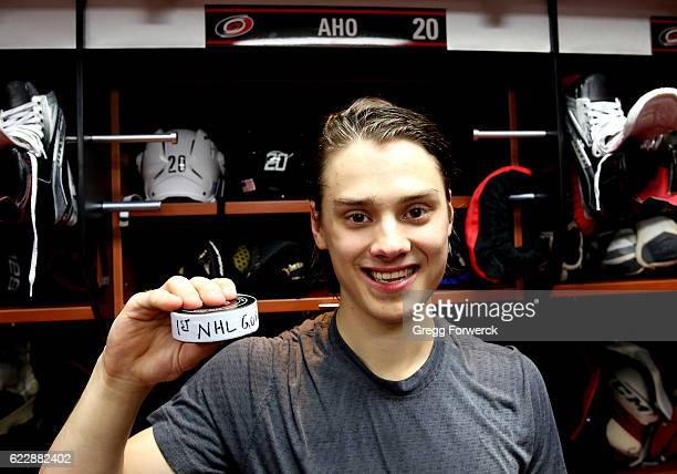 Sebastian Aho of the Carolina Hurricanes scores his first NHL goal against the Washington Capitals during an NHL game on November 12 2016 at PNC...