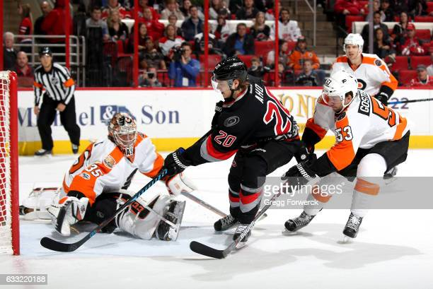 Sebastian Aho of the Carolina Hurricanes scores on Steve Mason of the Philadelphia Flyers during an NHL game on January 31 2017 at PNC Arena in...