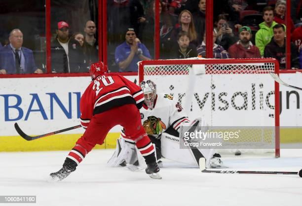 Sebastian Aho of the Carolina Hurricanes scores the game winning goal in overtime during an NHL game against the Chicago Blackhawks on November 12...