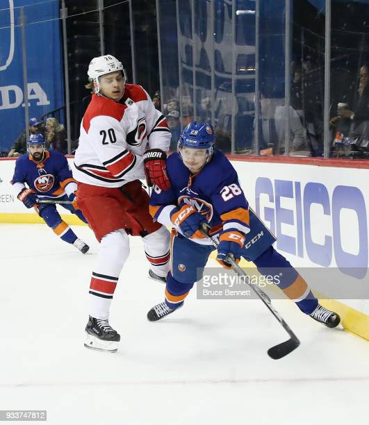 Sebastian Aho of the Carolina Hurricanes skates against Sebastian Aho of the New York Islanders during the first period at the Barclays Center on...