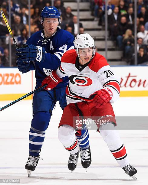 Sebastian Aho of the Carolina Hurricanes skates around Morgan Rielly of the Toronto Maple Leafs during the second period at the Air Canada Centre on...