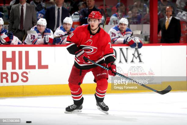 Sebastian Aho of the Carolina Hurricanes skates for a loose puck during an NHL game against the New York Rangers on March 31 2018 at PNC Arena in...