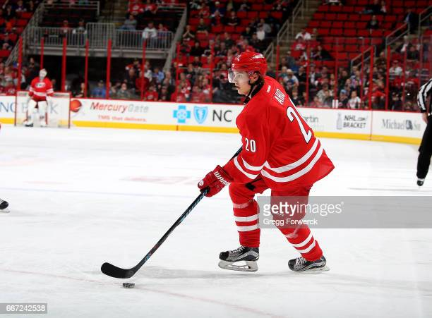 Sebastian Aho of the Carolina Hurricanes skates with a puck during an NHL game against the New York Islanders on April 6 2017 at PNC Arena in Raleigh...