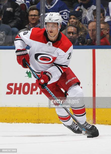 Sebastian Aho of the Carolina Hurricanes skates with the puck against the Toronto Maple Leafs during an NHL game at the Air Canada Centre on December...