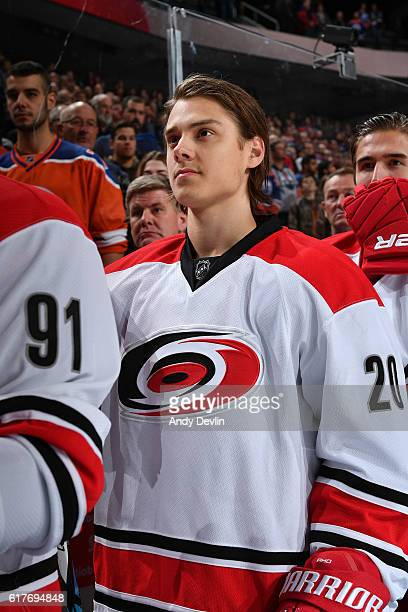 Sebastian Aho of the Carolina Hurricanes stands for the singing of the national anthem prior to the game against the Edmonton Oilers on October 18...