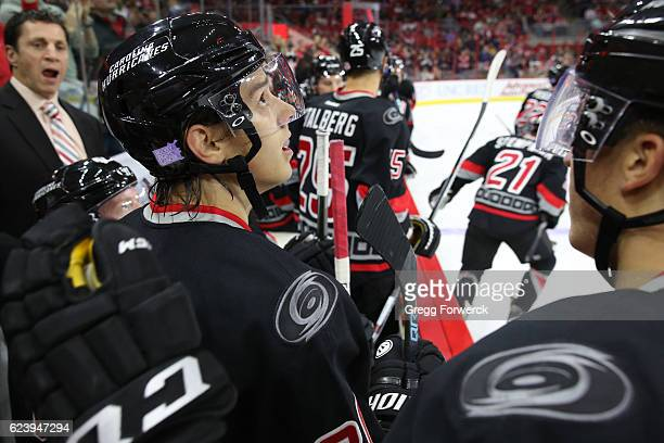 Sebastian Aho of the Carolina Hurricanes watches a replay of his first NHL goal during a game against the Washington Capitals on November 12 2016 at...
