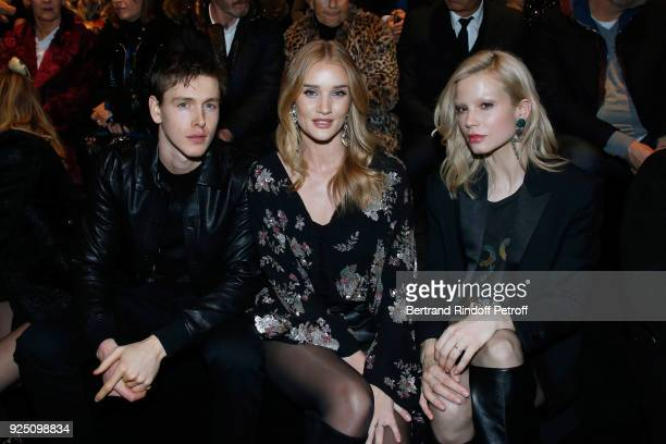Sebastian Akchote Rosie HuntingtonWhiteley and Dutch actress Sylvia Hoeks attend the Saint Laurent show as part of the Paris Fashion Week Womenswear...