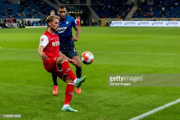 Sebastian Andersson of 1.FC Koeln and Kevin Akpoguma of TSG 1899 Hoffenheim battle for the ball during the Bundesliga match between TSG Hoffenheim...