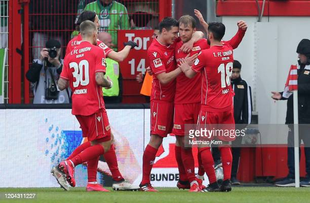 Sebastian Andersson of Berlin celebrates with teammates after scoring his team's first goal during the Bundesliga match between 1. FC Union Berlin...