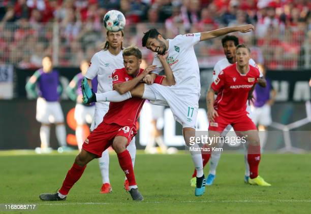 Sebastian Andersson of Berlin challenges for the ball with Nuri Sahin of Bremen during the Bundesliga match between 1. FC Union Berlin and SV Werder...