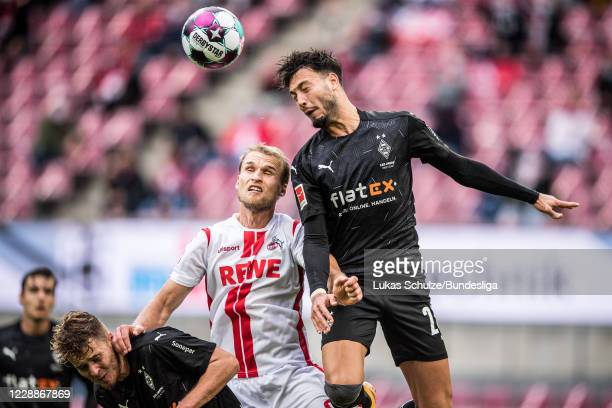 Sebastian Andersson of Köln and Ramy Bensebaini of Mönchengladbach in action during the Bundesliga match between 1 FC Köln and Borussia...
