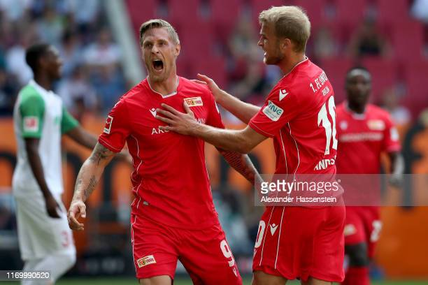 Sebastian Andersson of Union Berlin celebrates scoring the first team goal with his team mate Sebastian Polter during the Bundesliga match between FC...