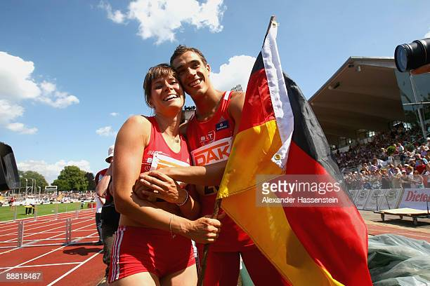 Sebastian Bayer kisses his girlfriend Carolin Nytra after winning his men's long jump event on day one of the German National Athletics Championships...