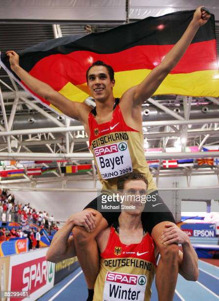 Sebastian Bayer of Germany celebrates winning the gold medal with Nils Winter after the Mens Long Jump Final during day three of the European...