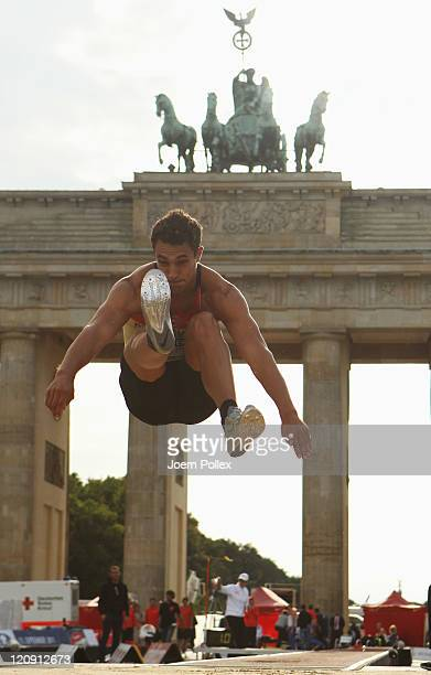 Sebastian Bayer of Germany competes in the Mens Long Jump during the Air Show 'Berlin fliegt' at Brandenburger Tor on August 12 2011 in Berlin Germany