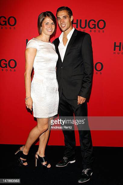 Sebastian Bayer und Carolin Nytra arrive for the Hugo By Hugo Boss show during the MercedesBenz Fashion Week Spring/Summer 2013 on July 5 2012 in...