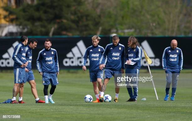Sebastian Beccacece assistant coach gives instructions to Mauro Icardi of Argentina during a training session at Argentine Football Association...