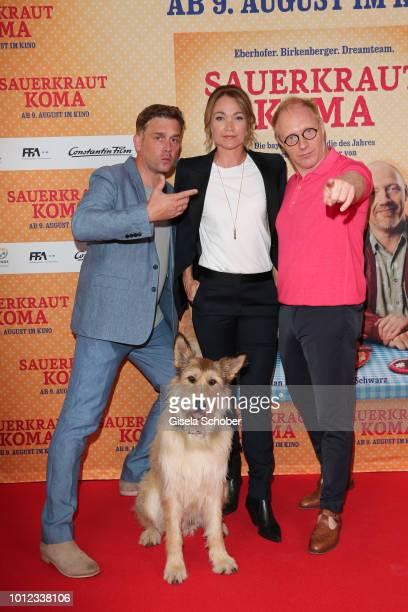 Sebastian Bezzel alias Franz Eberhofer Lisa Maria Potthoff alias Susi and Simon Schwarz alias Rudi Birkenberger and dog 'Ludwig' during the...
