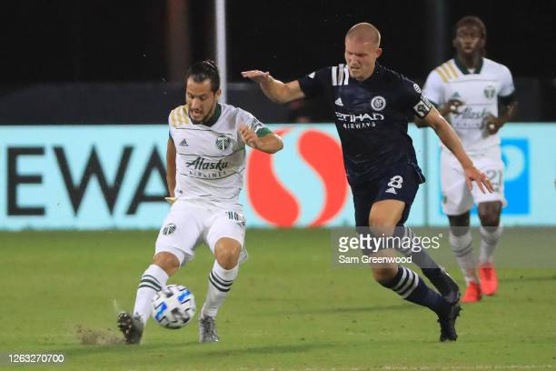 Sebastian Blanco of Portland Timbers fights for the ball with Alexander Ring of New York City during a quarter final match of MLS Is Back Tournament...