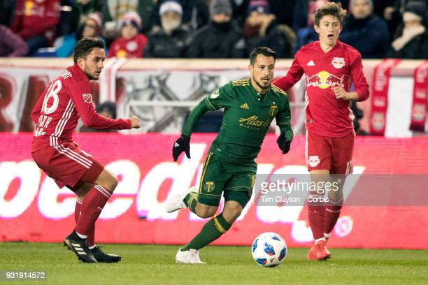 Sebastian Blanco of Portland Timbers in action while watched by Vincent Bezecourt of New York Red Bulls during the New York Red Bulls Vs Portland...