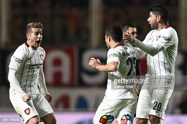 Sebastian Blanco of San Lorenzo celebrates with Nestor Ortigoza and Julio Buffarini after scoring the second goal of his team during a match between...