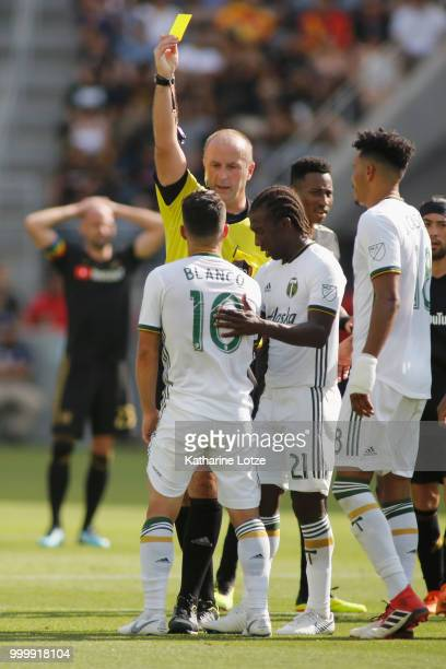 Sebastian Blanco of the Portland Timbers is given a yellow card at Banc of California Stadium on July 15 2018 in Los Angeles California