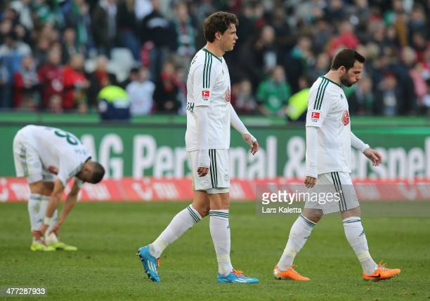 Sebastian Boenisch and Gonzalo Castro of Leverkusen react after the Bundesliga match between Hannover 96 and Bayer Leverkusen at HDIArena on March 8...