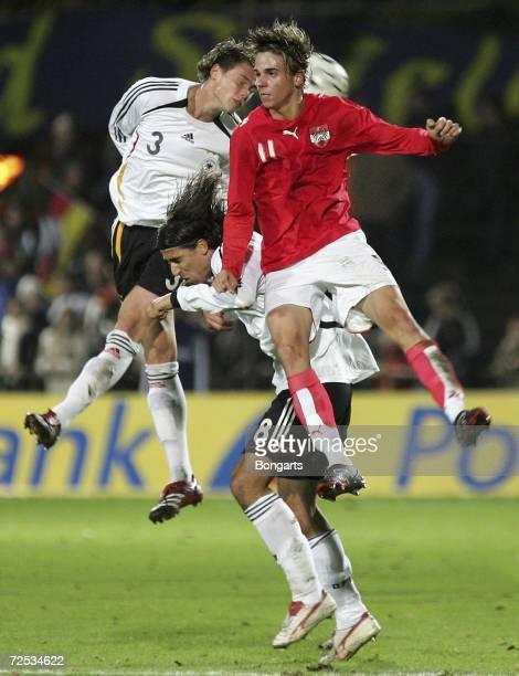 Sebastian Boenisch and Sami Khedira of Germany fight for the ball with Martin Harnik of Austria during the Men's U20 international friendly match...