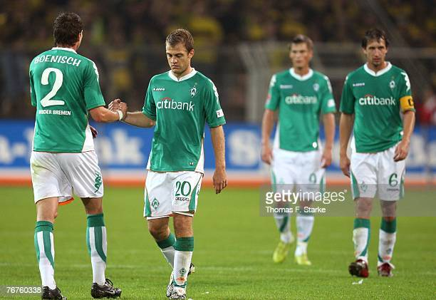 Sebastian Boenisch Daniel Jensen Markus Rosenberg and Frank Baumann of Bremen look dejected after during the Bundesliga match between Borussia...