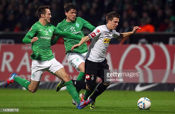 Sebastian Boenisch of Bremen fouls Patrick Hermann of Moenchengladbach during the Bundesliga match between SV Werder Bremen and Borussia...