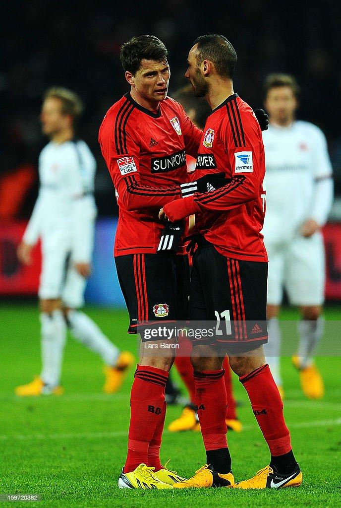 Sebastian Boenisch of Leverkusen celebrates with team mate Oemer Toprak after winning the Bundesliga match between Bayer 04 Leverkusen and Eintracht Frankfurt at BayArena on January 19, 2013 in Leverkusen, Germany.