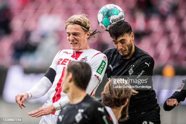 Sebastian Bornauw of Köln and Ramy Bensebaini of Mönchengladbach in action during the Bundesliga match between 1. FC Köln and Borussia...