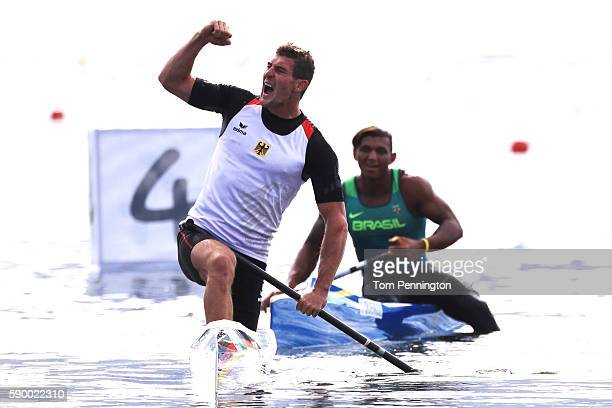 Sebastian Brendel of Germany and Isaquias Queiroz dos Santos of Brazil celebrate after competing during the Men's Canoe Single 1000m Final A on Day...