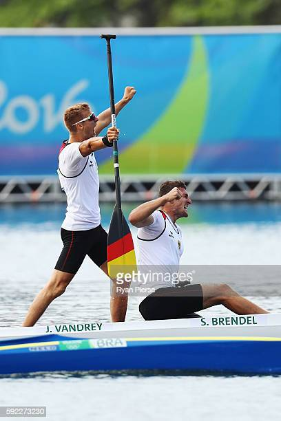 Sebastian Brendel of Germany and Jan Vandrey of Germany celebrate winning the Men's Canoe Double 1000m on Day 15 of the Rio 2016 Olympic Games at the...