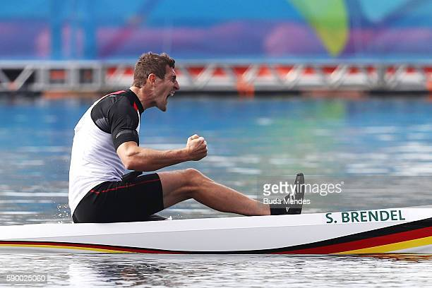 Sebastian Brendel of Germany celebrates after winning gold during the Men's Canoe Single 1000m Final A on Day 11 of the Rio 2016 Olympic Games at the...