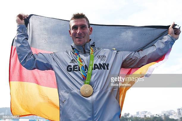 Sebastian Brendel of Germany celebrates on the podium after winning gold during the Men's Canoe Single 1000m Final A on Day 11 of the Rio 2016...