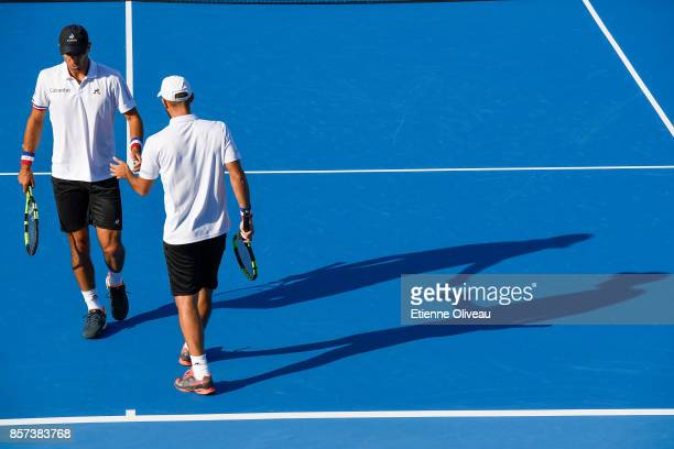 Sebastian Cabal and Robert Farah of Colombia celebrate a point during their Men's doubles quarterfinal match against Fabio Fognini of Italy and Robin...
