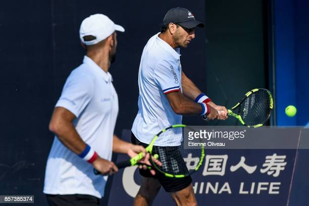Sebastian Cabal and Robert Farah of Colombia in action during their Men's doubles quarterfinal match against Fabio Fognini of Italy and Robin Hasse...