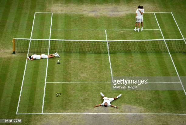 Sebastian Cabal of Colombia and playing partner Juan Robert Farah of Colombia celebrate match point in their Men's Doubles final against Nicolas...