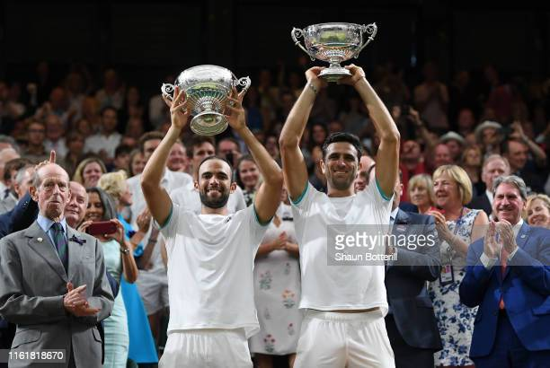 Sebastian Cabal of Colombia and playing partner Juan Robert Farah of Colombia celebrate victory with the winners trophy in their Men's Doubles final...
