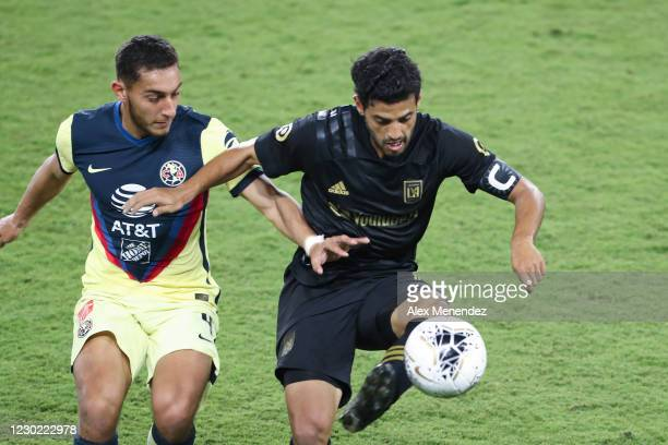 Sebastian Caceres of Club America and Carlos Vela of Los Angeles FC fight for the ball during the CONCACAF Champions League semifinal game at...